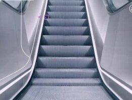 @JustAnEscalator – The world's only tweeting escalator